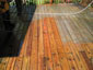 pressure treated deck during cleaning process